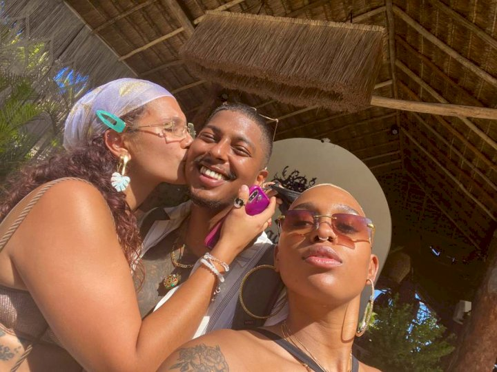 """He unlocked relationship premium"" – Reactions as man shows off his two girlfriends"