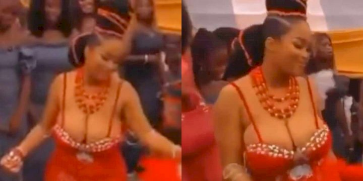 Bride takes center stage at her wedding ceremony as she rocks revealing outfit (Video)