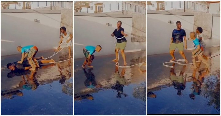 Mercy Johnson use a water hose as a gun in a fun shooting session with her kids (Video)