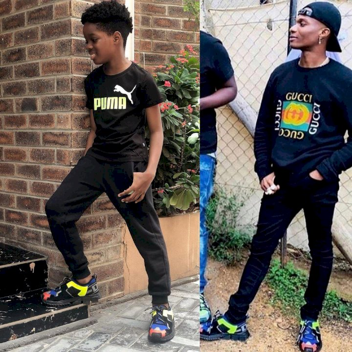 """Tell daddy I rocked his kicks better"" – Wizkid's son, Tife says as he poses in dad's shoes"