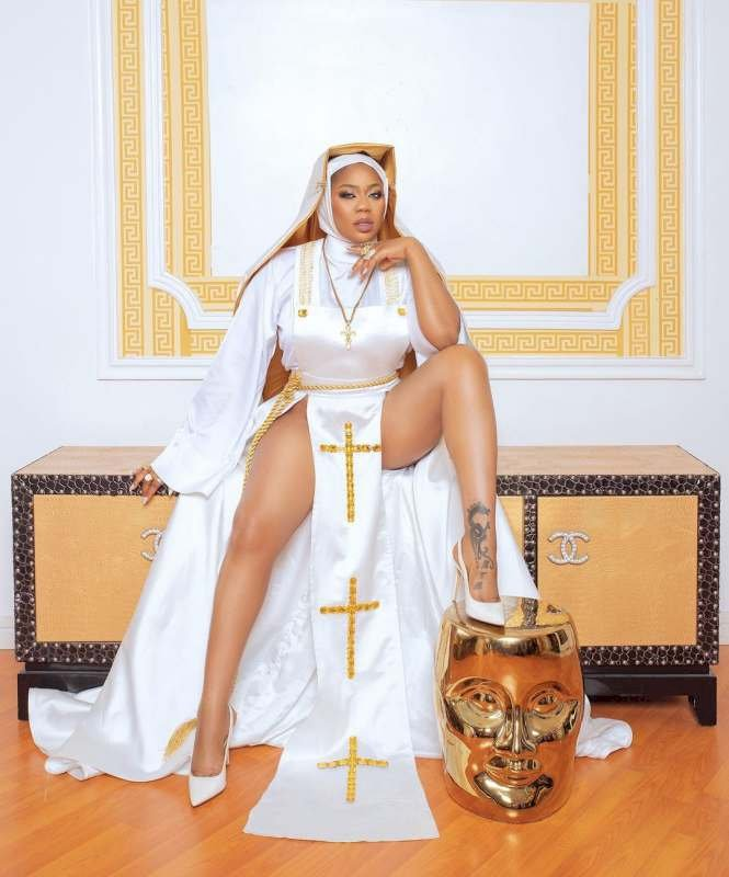 """All shades of wrong"" – Celebrity stylist, Toyin Lawani trigger reactions with nun-themed photos"